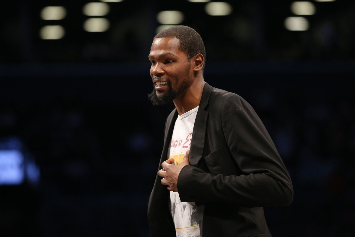Brooklyn Nets small forward Kevin Durant smiles during a time out during the second quarter against the Phoenix Suns at Barclays Center.