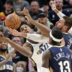 Utah Jazz center Hassan Whiteside (21) and New Orleans Pelicans center Jonas Valanciunas (17) reach for the rebound as New Orleans Pelicans guard Nickeil Alexander-Walker (6) and New Orleans Pelicans guard Kira Lewis Jr. (13) watch during a preseason NBA game at the Vivint Smart Home Arena in Salt Lake City on Monday, Oct. 11, 2021. The Jazz won 127-96.