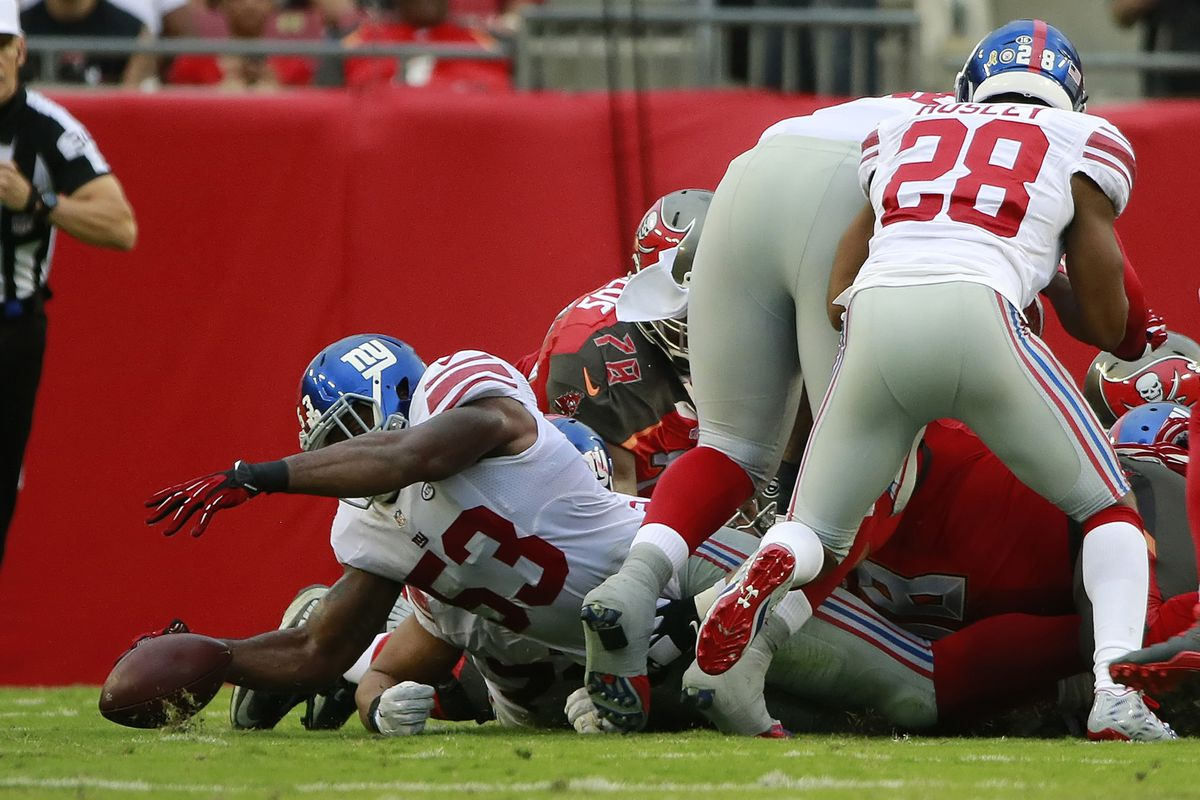 Jasper Brinkley dives to recover a fumble on Sunday