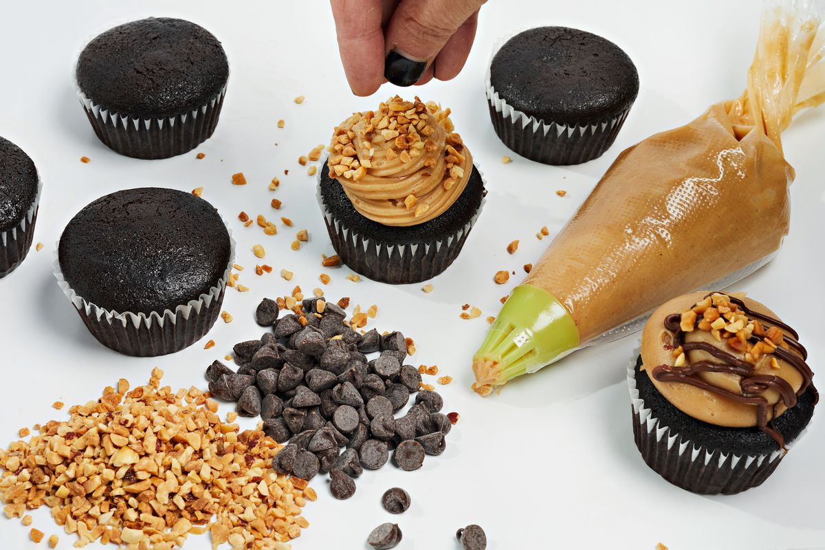A decorating kit from Sticky Fingers includes a piping bag and cupcake toppings like chocolate chips and peanuts