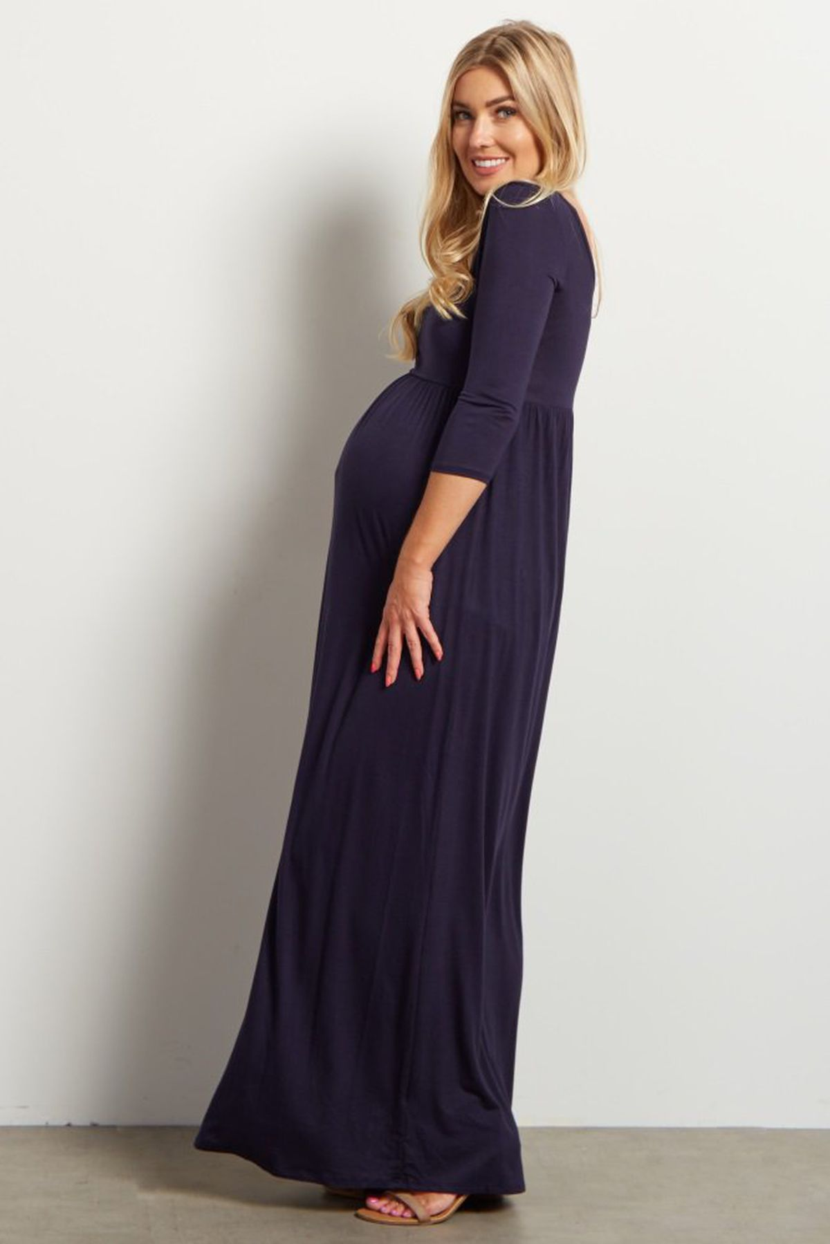 Where to buy good maternity clothes racked a model wearing a pink blush maternity maxi dress ombrellifo Gallery