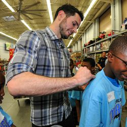 Magic guard J.J. Redick signs an autograph for a member from the Boys & Girls Clubs during the Magic and Pepsi holiday shopping spree event on December 18.