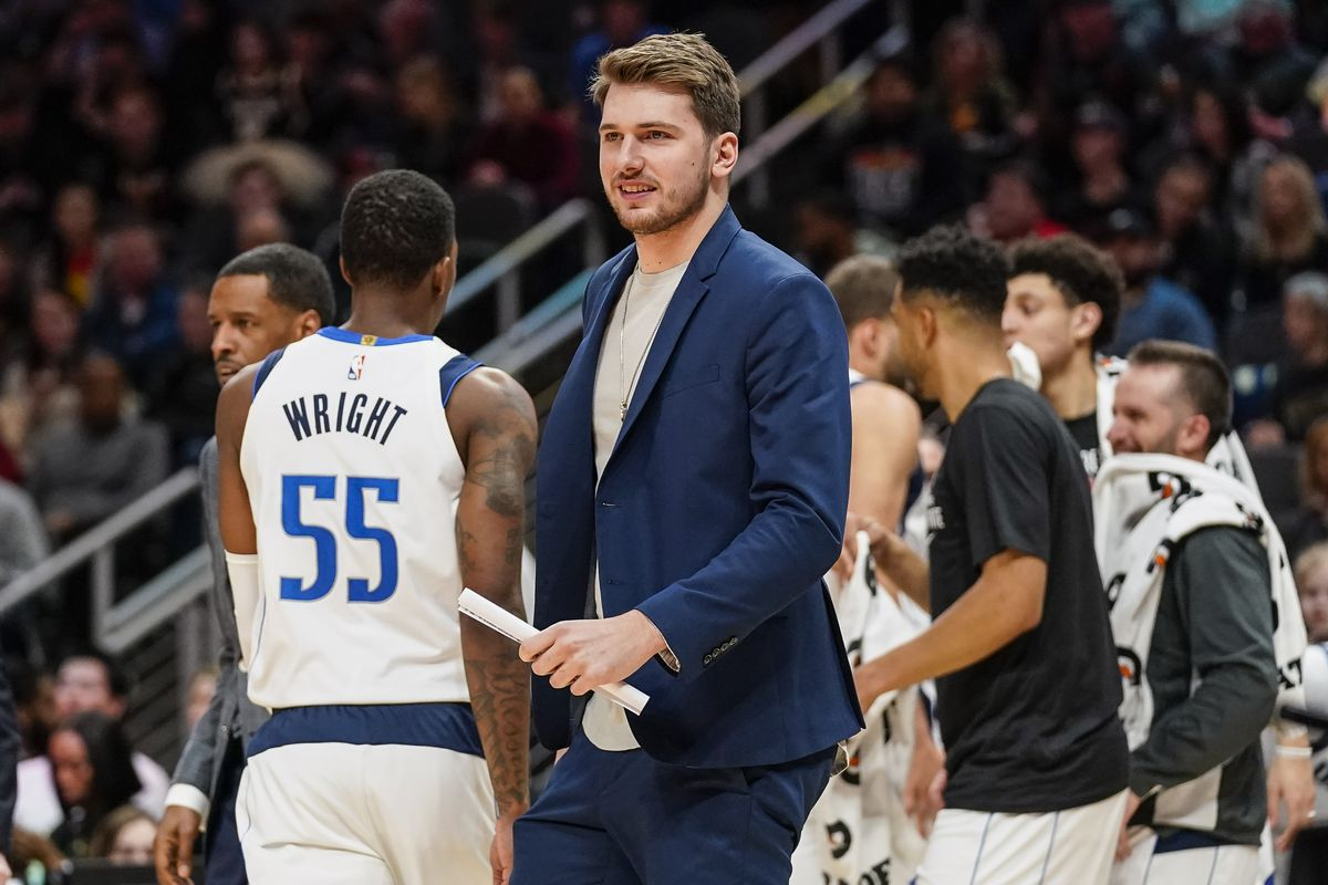 Dallas Mavericks guard Luka Doncic encourages his teammates during a timeout against the Atlanta Hawks during the second half at State Farm Arena.