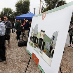 People gather to talk following a groundbreaking for the new Central Ninth Market in Salt Lake City, Wednesday, Oct. 28, 2015. The 9,216-square-foot commercial building will be occupied by six locally-owned small businesses, including Jade Market, which will stand as the first local food market in the neighborhood.