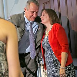 Former Utah Attorney General Mark Shurtleff gets a hug from his wife, M'Liss, after talking about charges of bribery and various other misconduct charges at the law offices of Snow, Christensen & Martineau in Salt Lake City Tuesday, July 15, 2014.