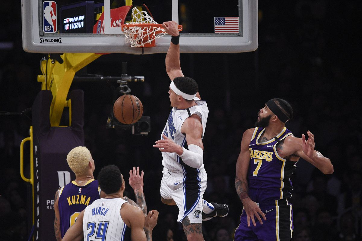 Orlando Magic forward Aaron Gordon dunks the ball past Los Angeles Lakers center JaVale McGee during the second half at Staples Center.