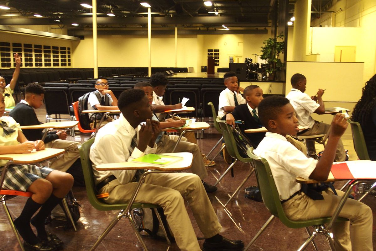 Memphis Business Academy is using makeshift classrooms in the auditorium to keep up with student enrollment, which is at about 1,000 students at the charter school's Frayser campus.