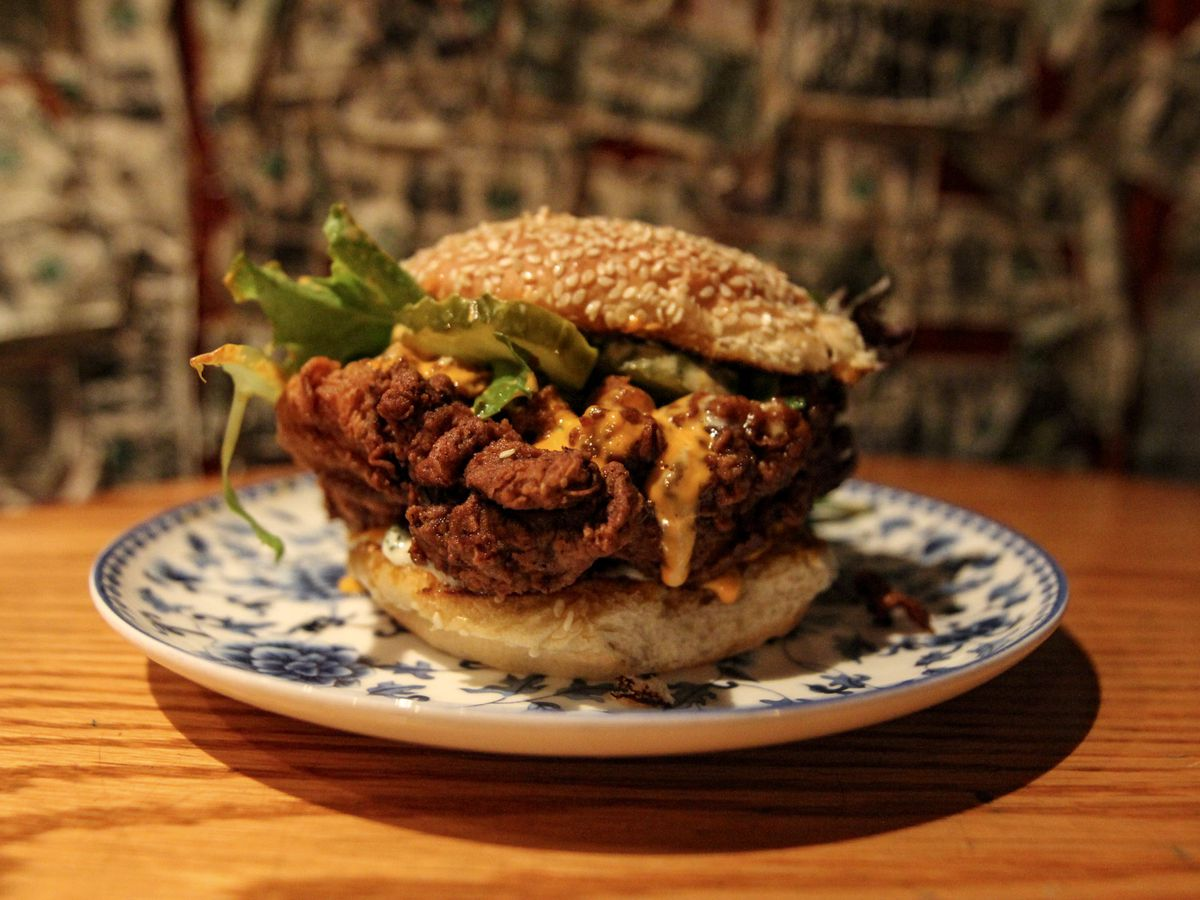 """A Rake's Progress chef Opie Crooks created a fried chicken sandwich for Service Bar with """"Snake Oil"""" hot suace butter and buttermilk dressing."""