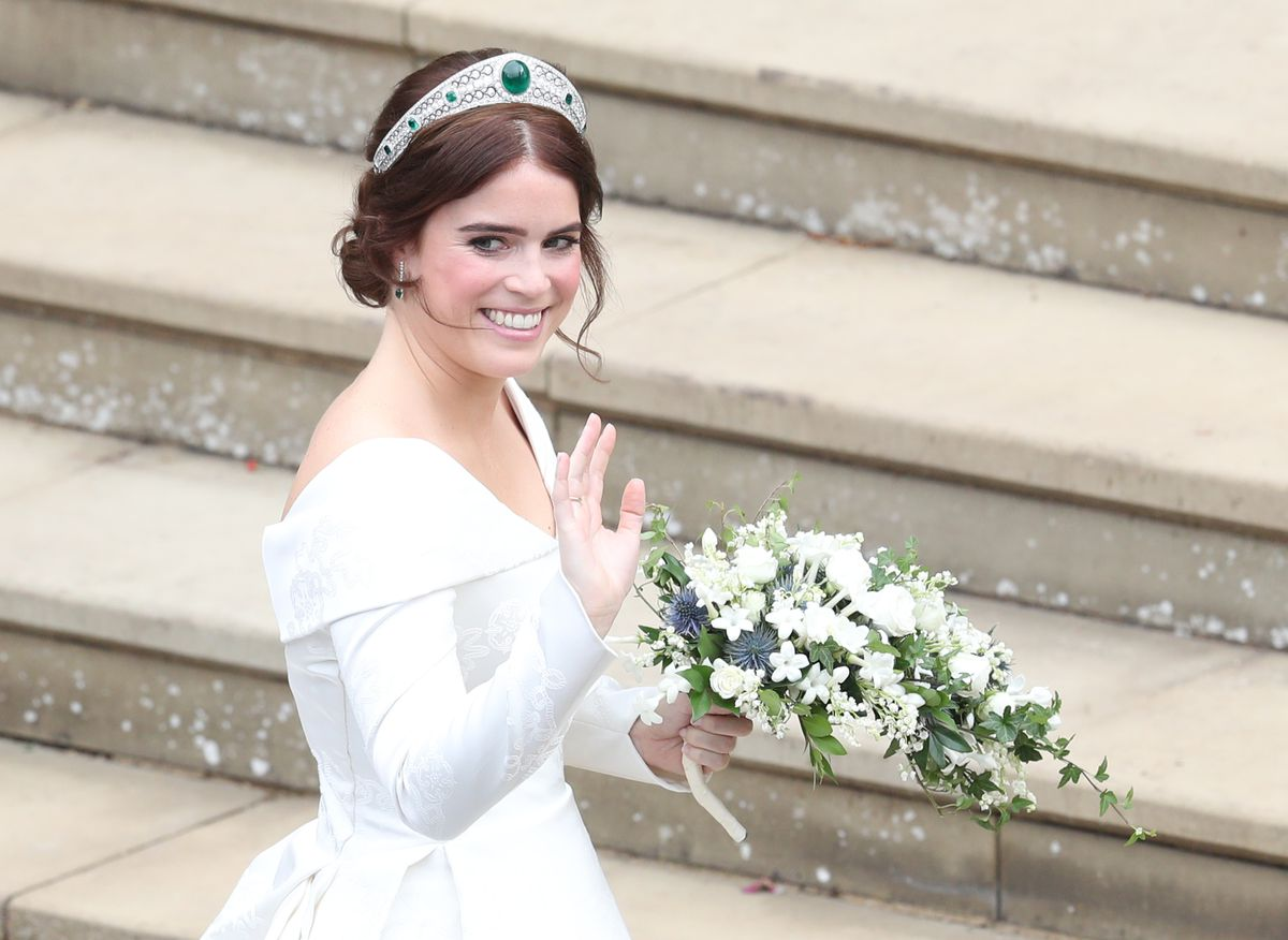 Princess Eugenie stands on the steps of the chapel.