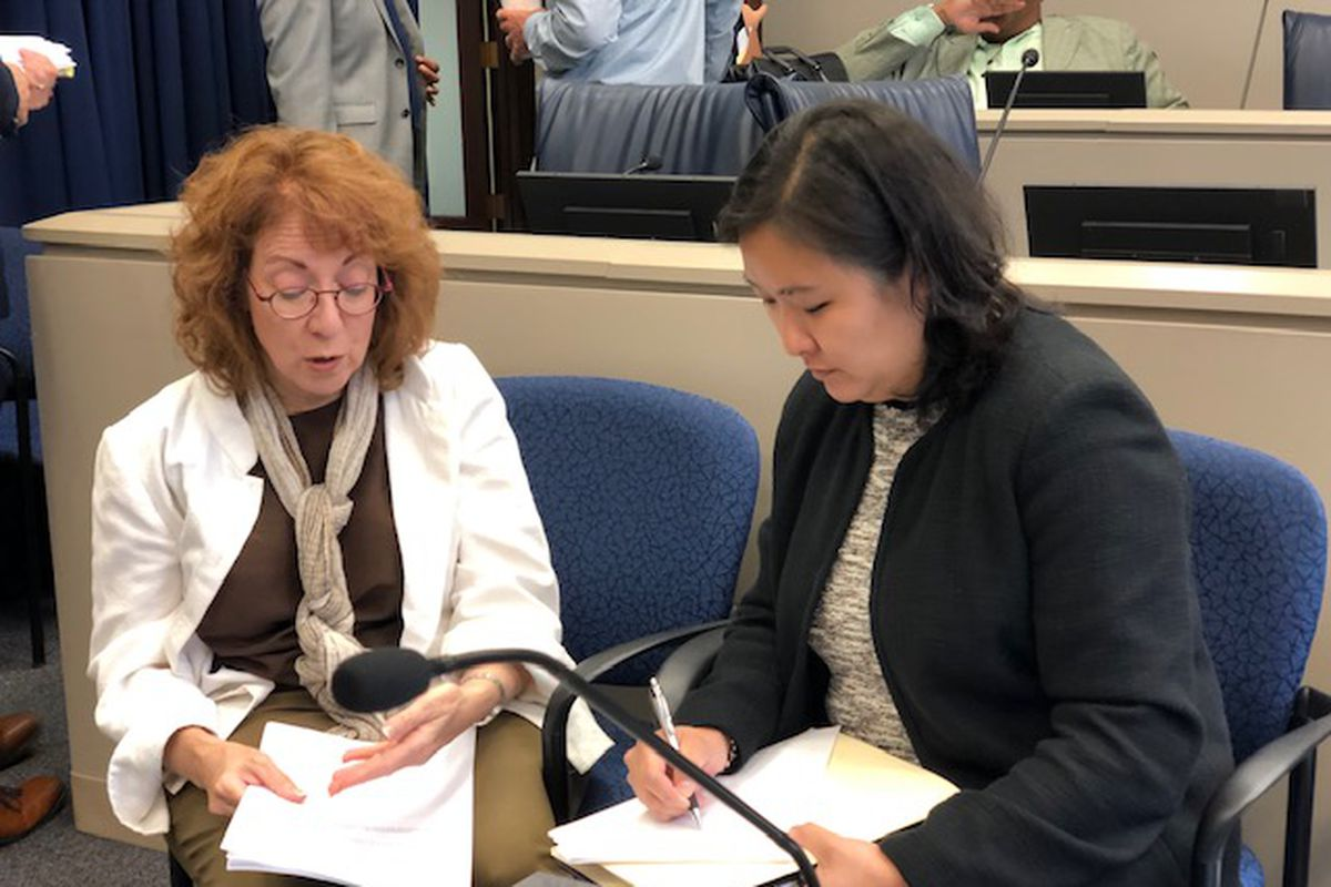 Ald. Michele Smith (43rd), left, and Budget Director Susie Park talk after a Budget Committee meeting Monday, July 22, 2019.