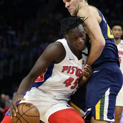 Detroit Pistons forward Sekou Doumbouya (45) collides with Utah Jazz forward Bojan Bogdanovic (44) while driving to the basket during the first half of an NBA basketball game Saturday, March 7, 2020, in Detroit.