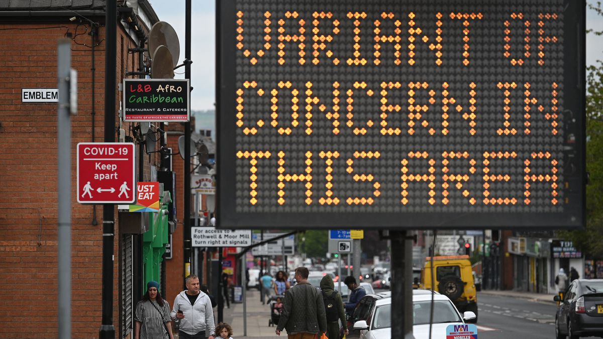 A public health digital board warns the public of a Covid-19 variant of concern affecting the community in Bolton, northwest England, on May 14, 2021.