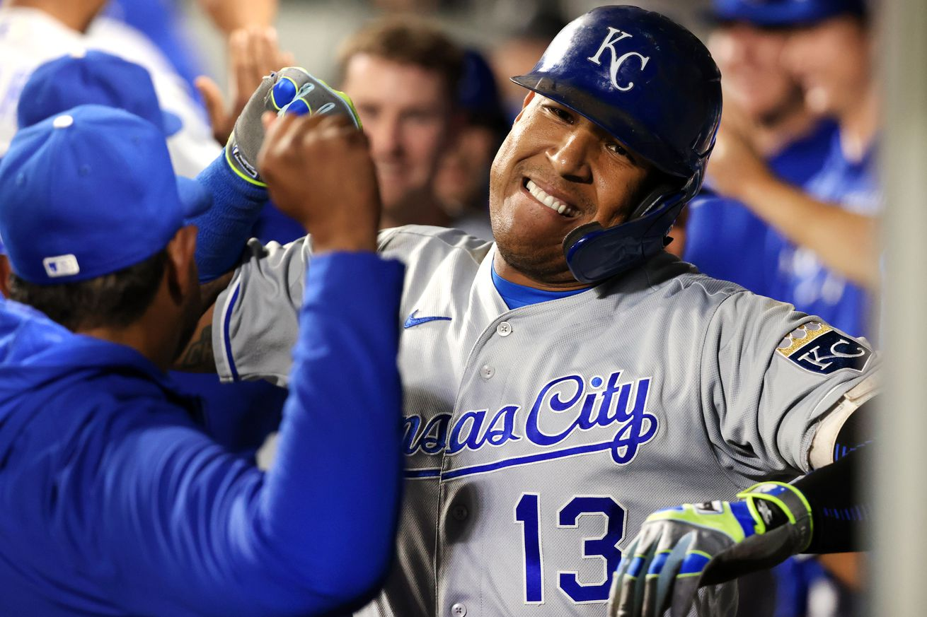 Salvador Perez #13 of the Kansas City Royals celebrates with teammates in the dugout after hitting a grand slam to tie the game 5-5 against the Seattle Mariners in the fifth inning at T-Mobile Park on August 27, 2021 in Seattle, Washington.