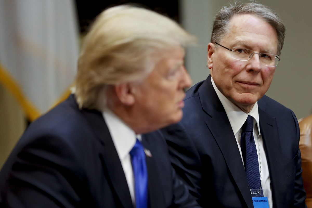 FILE - In a Feb. 1, 2017, file photo, National Rifle Associations (NRA) Executive Vice President and Chief Executive Officer Wayne LaPierre listens at right as President Donald Trump speaks in the Roosevelt Room of the White House in Washington. In the la