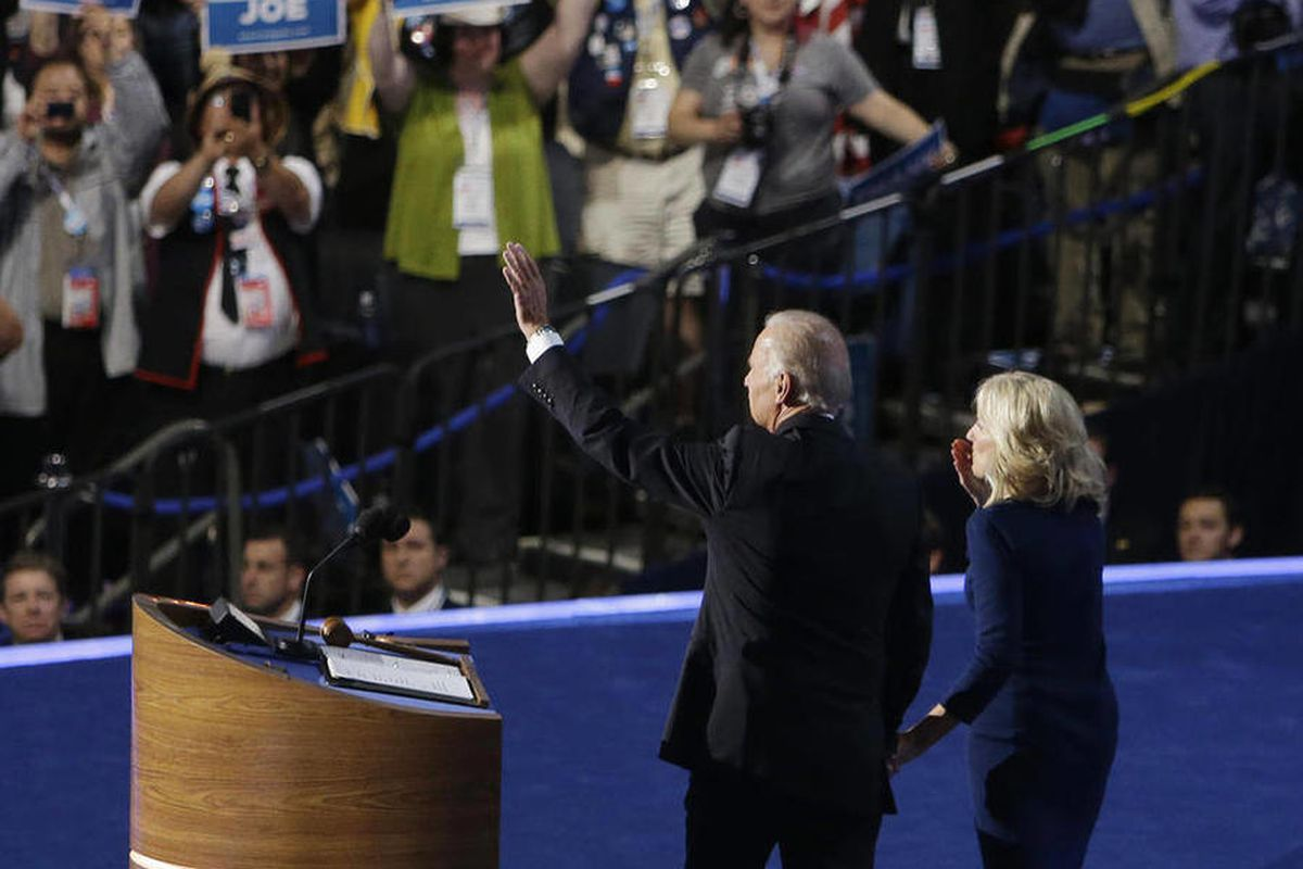 Vice President Joe Biden and his wife Jill wave to delegates after his speech at the Democratic National Convention in Charlotte, N.C., on Thursday, Sept. 6, 2012.