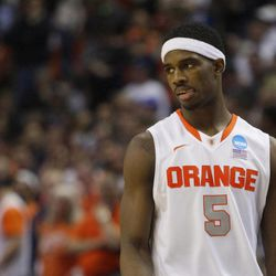 Syracuse forward C.J. Fair (5) reacts late in the second half of a third-round game against Dayton in the NCAA men's college basketball tournament in Buffalo, N.Y., Saturday, March 22, 2014. Dayton won the game 55-53. (AP Photo/Bill Wippert)