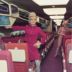 """Modeling the Pucci uniform in 1966. Photo via <a href-""""http://www.parade.com/157933/iraphael/high-style-flight-attendant-fashion-through-the-years/#p37"""">Parade.com.</a>"""