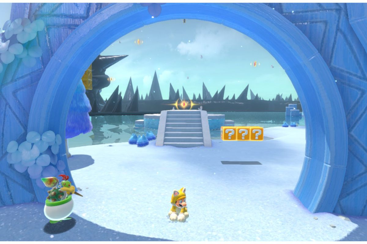 Cat Mario sits under the gate to Trickity Tower