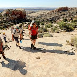 Interior Secretary Sally Jewell, hikes with guide Vaughn Hadenfeldt and others toward Comb Ridge as she visits rock art sites, some of whic have been vandalized in southern Utah on Saturday, July 16, 2016.