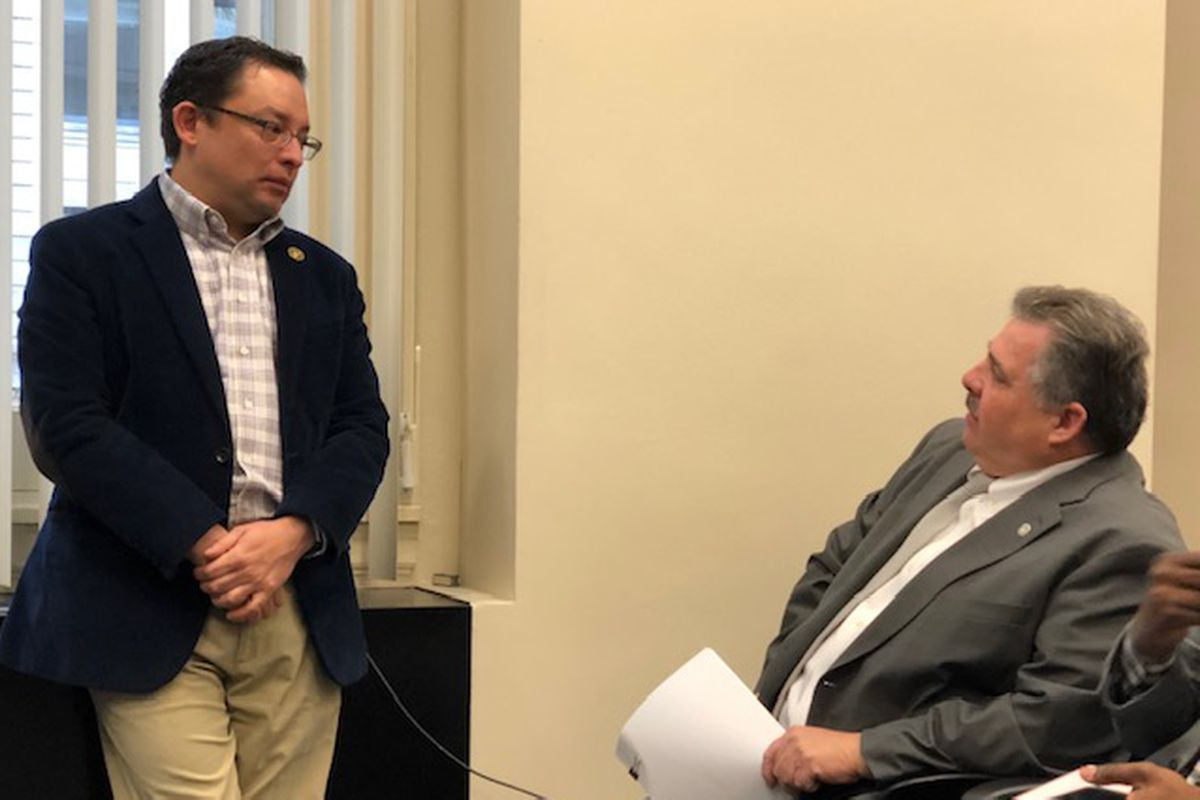 Fraternal Order of Police President Kevin Graham (right) talks to Ald. Ray Lopez (15th) (left) before Tuesday's Public Safety Committee meeting. Graham showed up to testify against civilian police review, but he never got the chance.