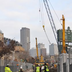 Looking east on Waveland through the open work site gate