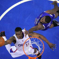Los Angeles Clippers guard Eric Bledsoe, left, shoots as Sacramento Kings forward Donte Greene defends during the first half of their NBA basketball game, Saturday, April 7, 2012, in Los Angeles.