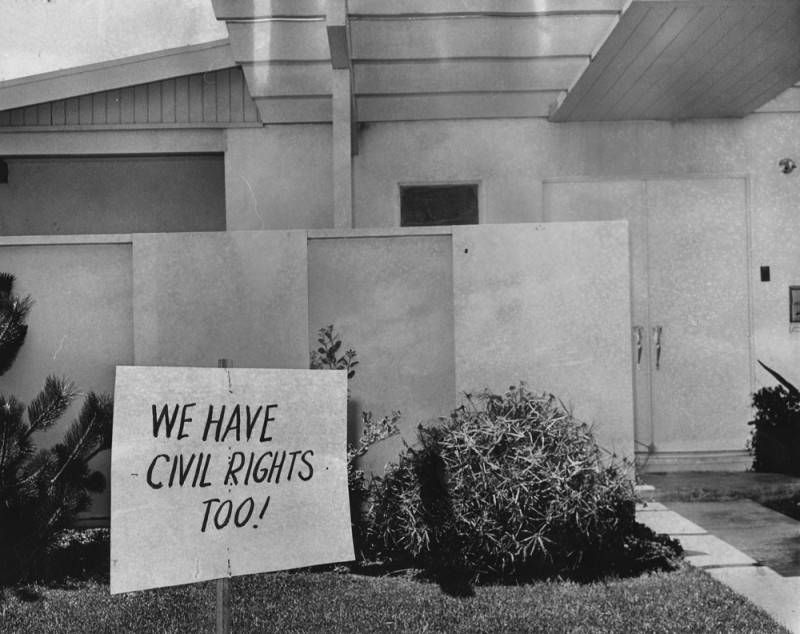 """A close-up of a home with a lawn sign that reads """"We have civil rights too!"""""""