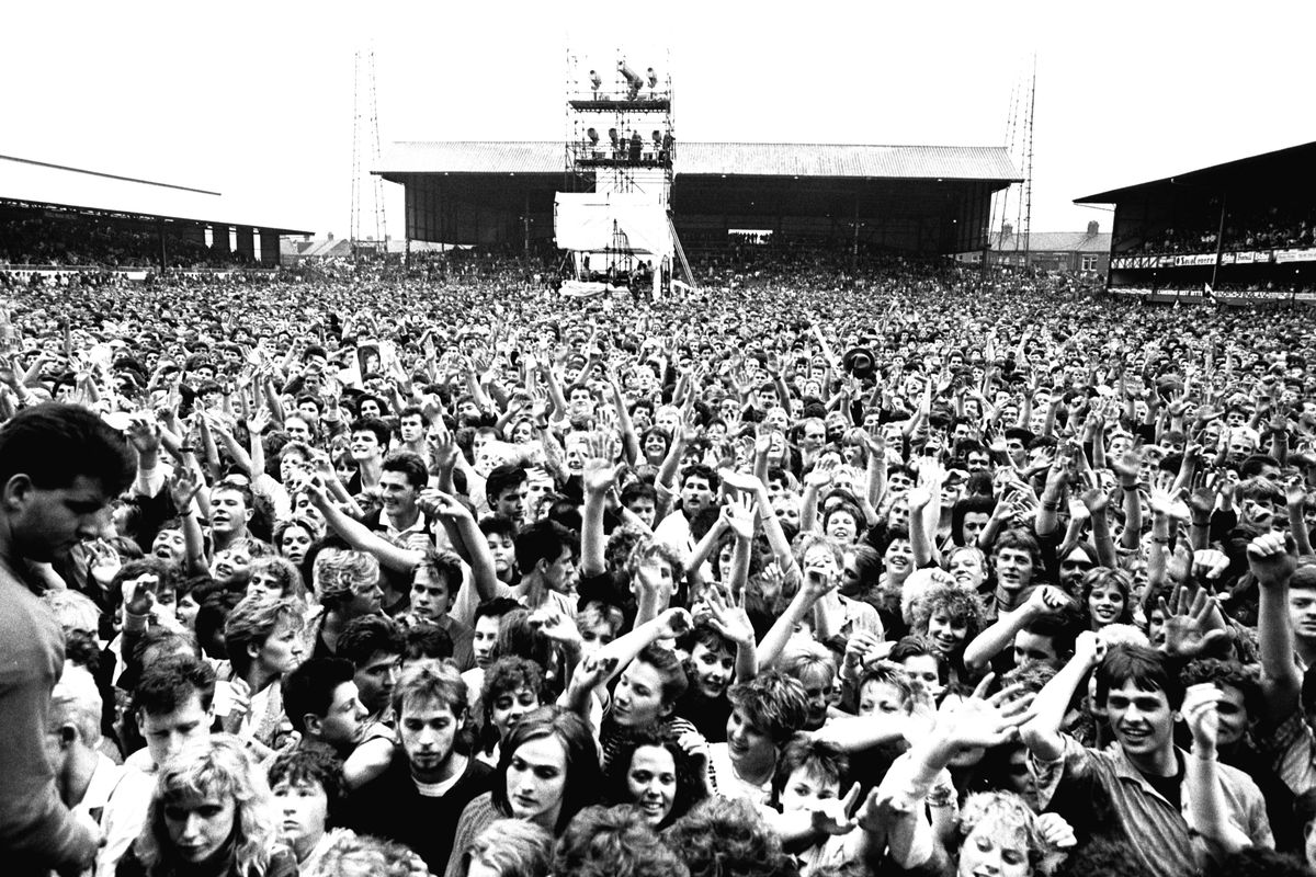 David Bowie performing at Roker Park, Sunderland on 23rd June 1987 in his Glass Spider Tour Fans enjoying the concert