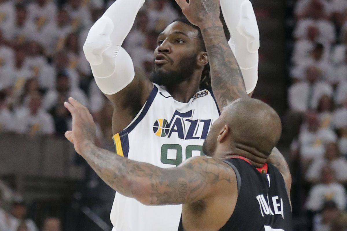 Utah Jazz forward Jae Crowder (99) shoots over Houston Rockets forward PJ Tucker (17) during Game 4 of the NBA Playoffs at the Vivint Smart Home Arena in Salt Lake City on Monday, April 22, 2019.