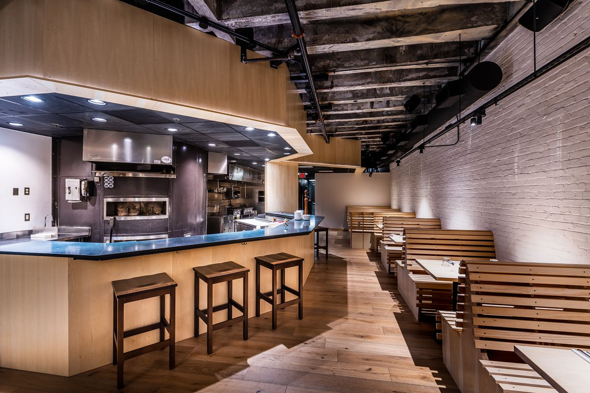 The floor and booths at Tonari are made out of light blonde wood