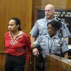 Bailiffs bring Annette Morales-Rodriguez, left, into a Milwaukee County courtroom on Thursday, Sept. 20, 2012, shortly before a jury convicted her of killing a pregnant woman and slicing out her full-term fetus last year. Morales-Rodriguez now faces a mandatory life sentence, although a judge could allow for the possibility of parole.
