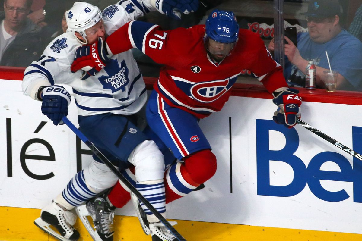 Feb 14, 2015; Montreal, Quebec, CAN; Toronto Maple Leafs center Leo Komarov (47) is checked into the boards by Montreal Canadiens defenseman P.K. Subban (76) during the third period at Bell Centre.