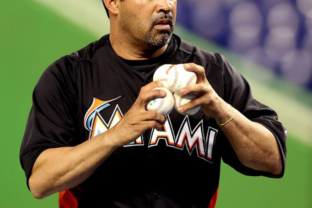 May 22, 2012; Miami, FL, USA;  Miami Marlins manager Ozzie Guillen (13) throws batting practice before a game against the Colorado Rockies at Marlins Park. Mandatory Credit: Robert Mayer-US PRESSWIRE