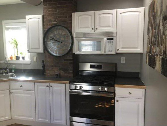 A frontal shot of a kitchen counter and cabinetry.