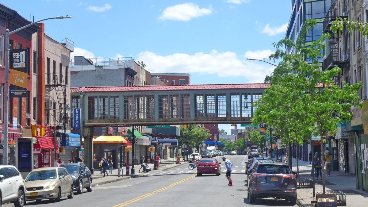 A walkway extends across Fulton Street