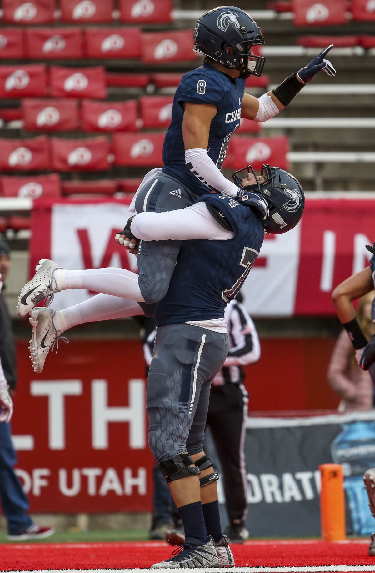 Corner Canyon wide receiver Noah Kjar (8) is lifted into the air by Corner Canyon offensive lineman Jackson Light (74) after scoring a touchdown during the first half of the 6A state high school football game at Rice-Eccles Stadium in Salt Lake City on Friday, Nov. 22, 2019.