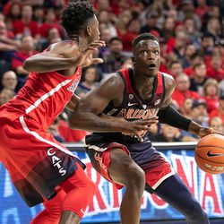 Emmanuel Akot, right, looks towards the basket during the 2018 Red-Blue game in McKale Center on October 14 2018 in Tucson, Ariz.