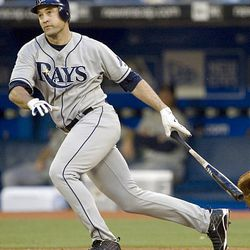 Tampa Bay Rays' Pat Burrell watches his two-run single hit the left-field.