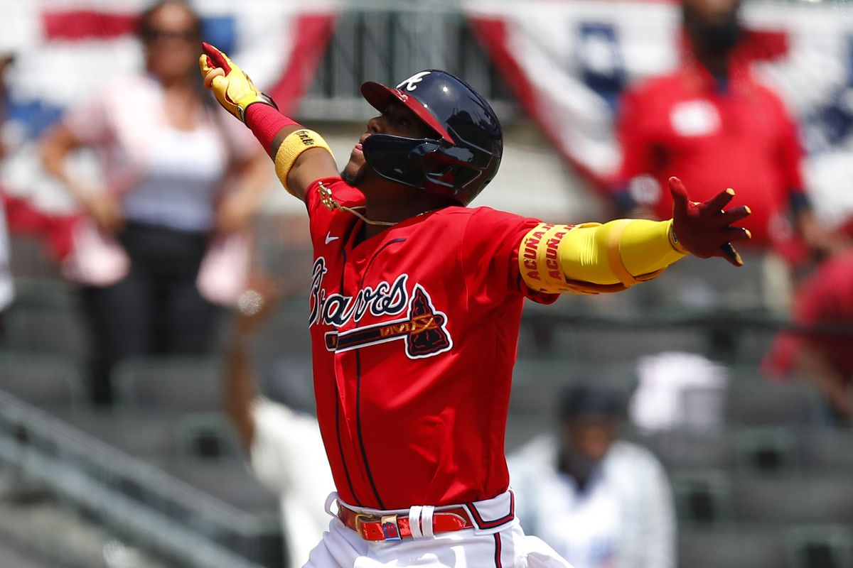 Ronald Acuna Jr jumps with joy after hitting homer.