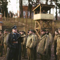 """Urs Rechn, center left, plays German officer Klaus Schmidt calling roll at a prisoner-of-war camp in northern Germany in """"Instrument of War."""""""