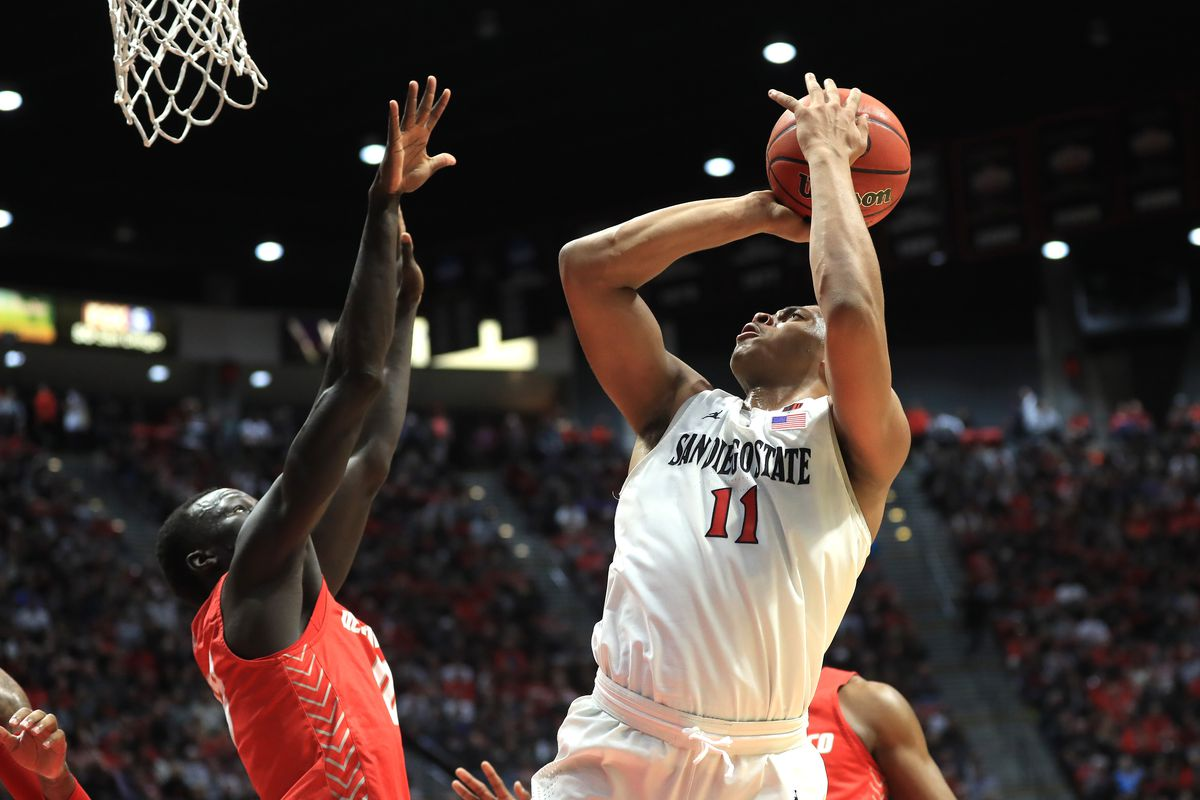 Matt Mitchell of the San Diego State Aztecs shoots over the defense of Makuach Maluach of the New Mexico Lobos during the first half of a game at Viejas Arena on February 11, 2020 in San Diego, California.