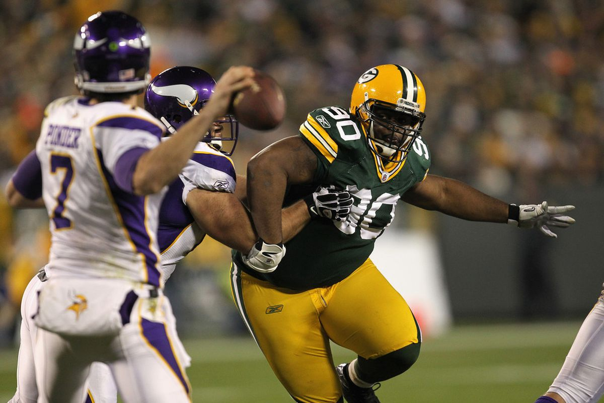 GREEN BAY, WI - NOVEMBER 14:  B.J. Raji #90 of the Green Bay Packers applies a pass rush against Christian Ponder #7 of the Minnesota Vikings at Lambeau Field on November 14, 2011 in Green Bay, Wisconsin.  (Photo by Jonathan Daniel/Getty Images)