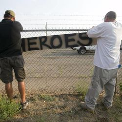 Two men place a hero sign in front of Prescott Fire Station #7 on Monday, July 1, 2013, in Prescott, Ariz. Eighteen firefighters from the Prescott Fire Department's Granite Mountain Hotshots team and a 19th firefighter from another crew were killed battling the Yarnell Hill Fire on Sunday. The Granite Mountain Hotshots were based out of Prescott Fire Station #7. David Wallace/The Arizona Republic