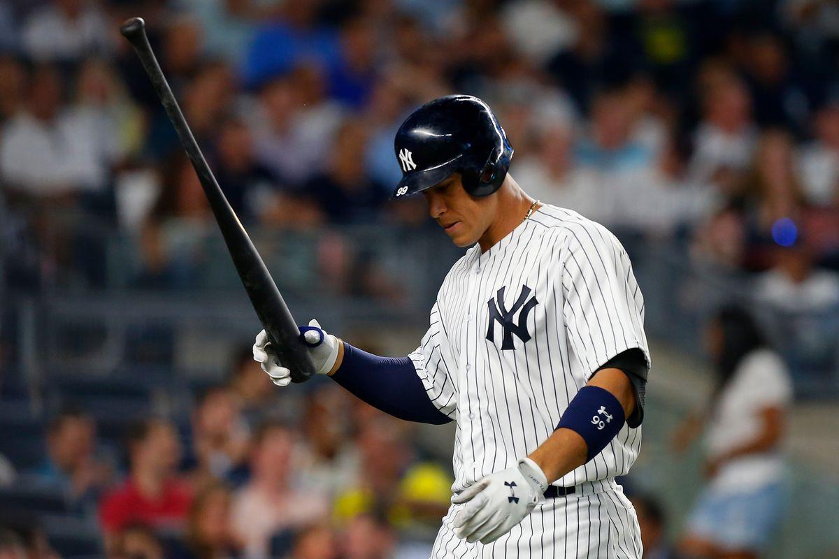 Aaron Judge holding a bat after striking out