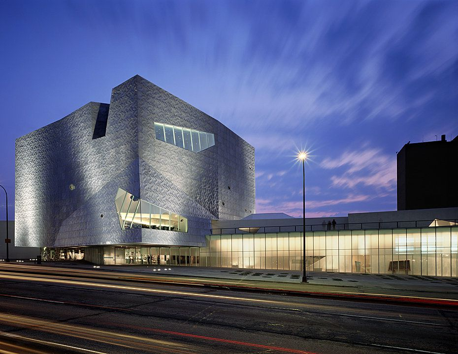 The exterior of the Walker Art Center in Minnesota. The facade is steel and curved.