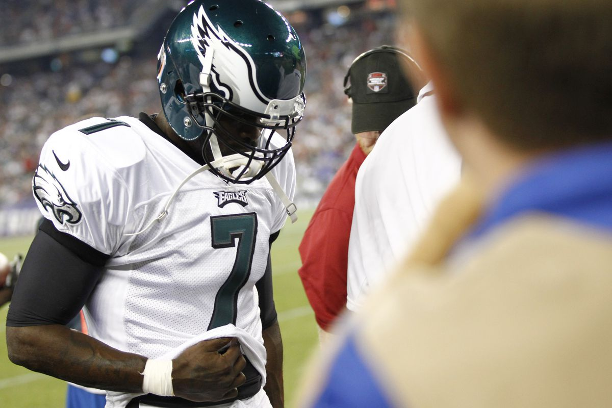 Aug 20, 2012; Foxborough, MA, USA; Philadelphia Eagles quarterback Michael Vick (7) walks to the locker room during the first half of a game against the New England Patriots at Gillette Stadium.  Mandatory Credit: Mark L. Baer-US PRESSWIRE