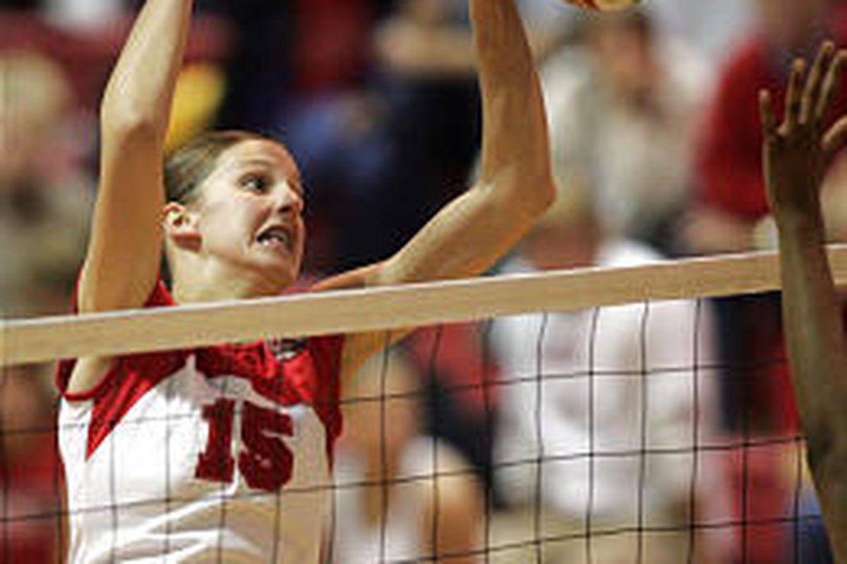 Utah's Emillie Toone (15) returns the ball Friday against Wyoming.