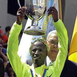 Wesley Korir of Kenya hold his trophy after winning the men's division of the 2012 Boston Marathon in Boston, Monday, April 16, 2012.