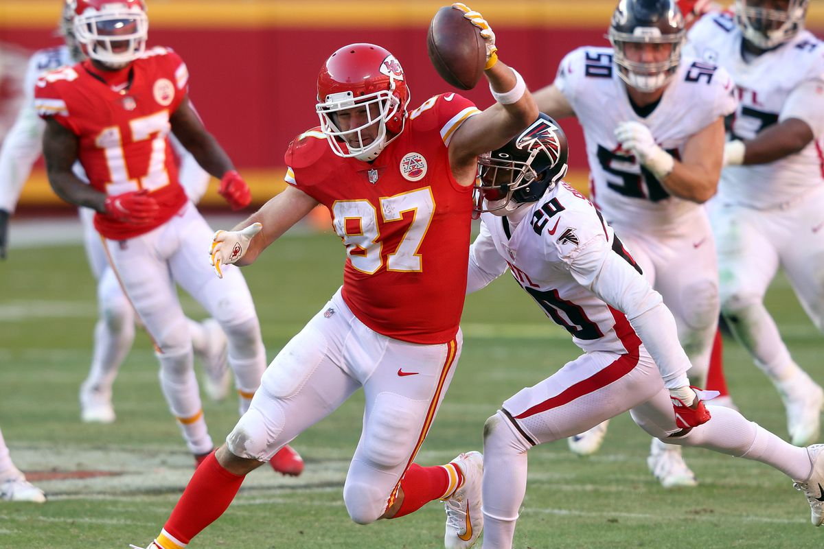 Travis Kelce #87 of the Kansas City Chiefs carries the ball after a catch against the Atlanta Falcons during the fourth quarter at Arrowhead Stadium on December 27, 2020 in Kansas City, Missouri.