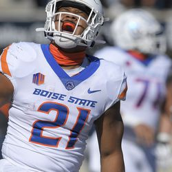 Boise State running back Andrew Van Buren (21) celebrates after scoring a 2-yard touchdown during the first half of an NCAA college football game against Utah State on Saturday, Sept. 25, 2021, in Logan, Utah.